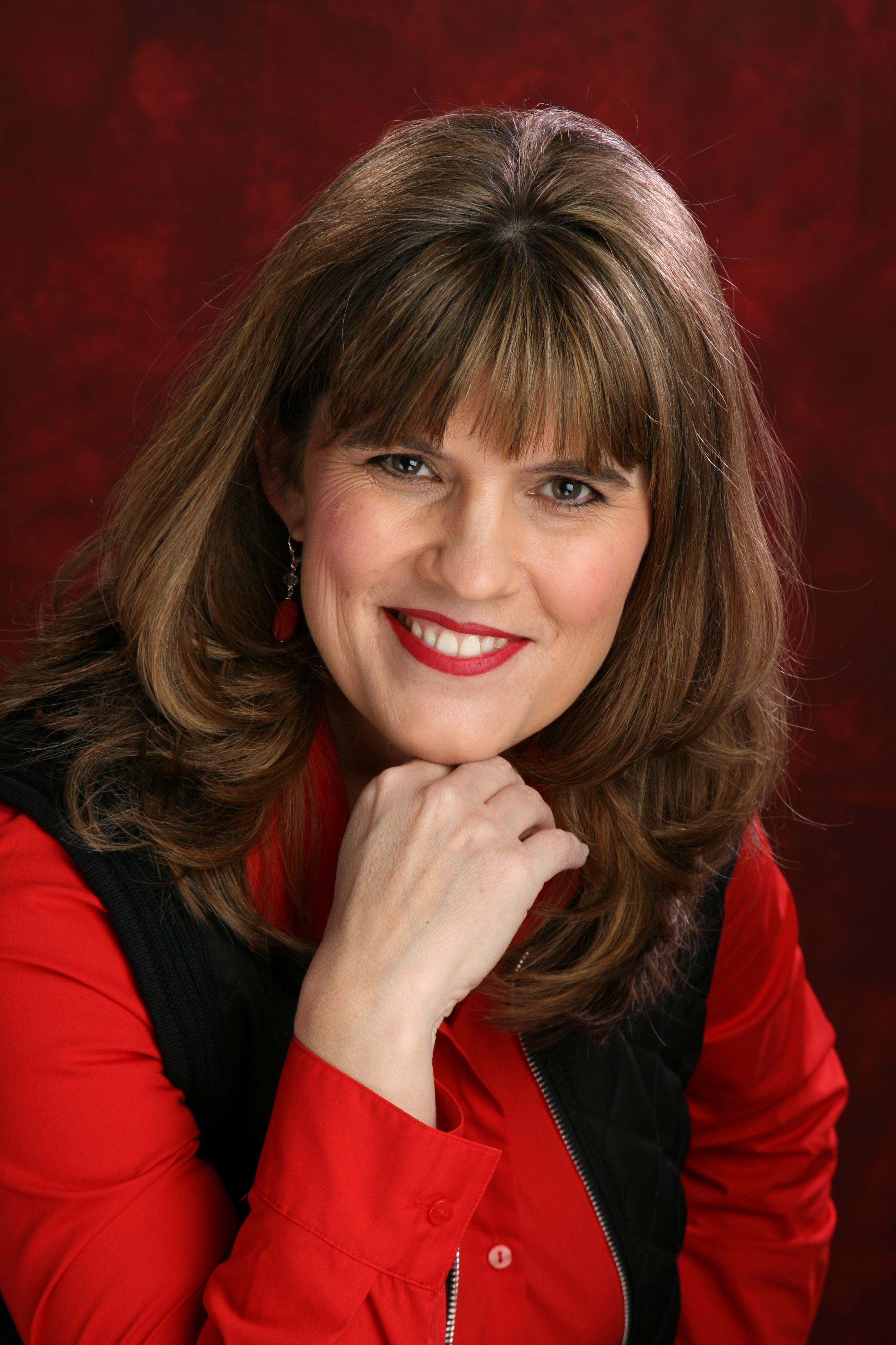 Author Jodi Ashland with hand on chin.jpg